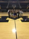Interns posing on the Michigan basketball court at the development community's summer party.